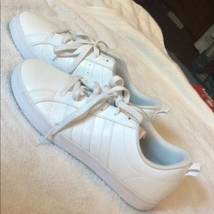 All white Adidas sneakers